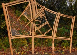Picture frames in a forest landscape, in the frames are more frames in a way which wouldn't be physically possible.