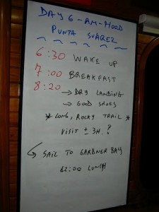 A whiteboard listing schedule for a rafting holiday